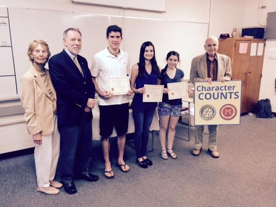 The Rotary Club of Madison invited Madison High School juniors to participate in a Laws of Life Essay Award. Pictured here left to right are Rotarian Pat Miller, Rotary President Ray Freaney, Joe O'Connor, Lauren Emmerich, Brianna Brown, and Rotarian Steve Byrd.