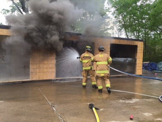 Firefighters and insurance agents from across the Mid-South took part in a training at Germantown Fire Station 4, 3031 Forest Hill-Irene, that showed how differently fires in different rooms of house may burn. (Jane Roberts/The Commercial Appeal)