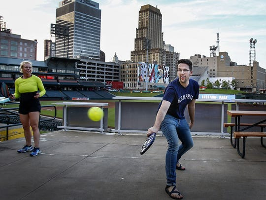 September 1, 2016 - Jake Cacher hits a return shot during a game of pickleball, a sport that combines elements of tennis, badminton and ping-pong at the Memphis Open tennis booth. Hundreds gathered at AutoZone park to celebrate all things Memphis during 901 Day at Exposure. Local venders provided information on how to get involved with their organizations as well as offering free giveaways. (Mark Weber/The Commercial Appeal)
