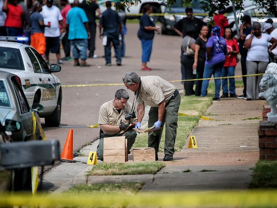 Shelby County investigators collect evidence from the scene on Longtree north of Raleigh on June 27, 2016, after witnesses say Andre Jones was shot and killed while leaving the home of his fiancee.