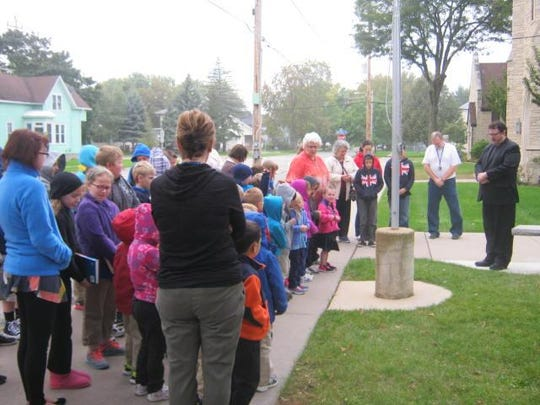 "Trinity Lutheran School in Menasha joined schools all over America in celebrating ""Gather at the Pole"" on Sept. 28."