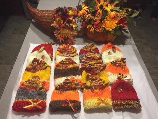 Some of the Thanksgiving-themed newborn baby hats Mary Anne Burkhart, of Hilton, made for Highland Hospital this holiday season.