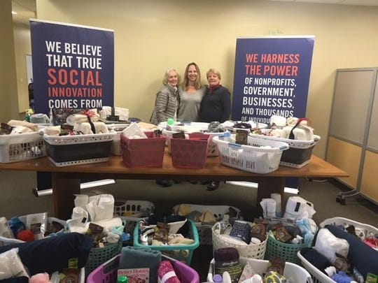 Melinda Moulton (Main Street Landing), Rachel Cummings (Age Well VT) and Ruthann Hackett (United Way of Northwest Vermont) pose with Giving from the Heart baskets.