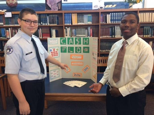 Middletown's Nyles Wiggins and James Ivery present information about cash flow at the Financial Fair.