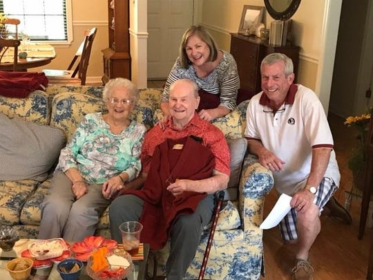 Roger Drohan, a pitcher on the 1949 FSU baseball team, sits next to his wife, Kathryn, as daughter Vicki Brokaw, left, and family friend Hal Barnett pose behind them.