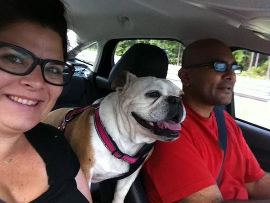 Millie enjoys a car ride with her parents, Stacey and