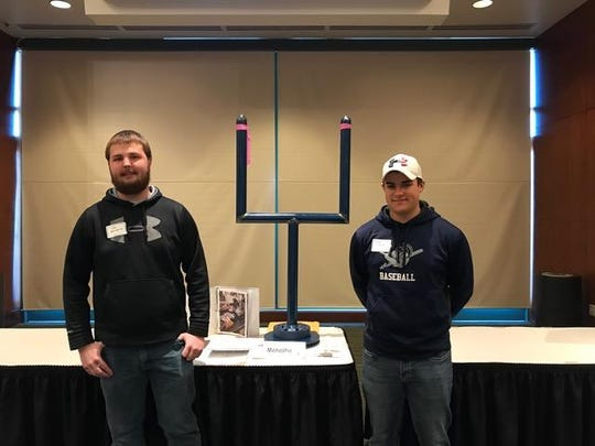 """Menasha High Welding students completed a """"Goal Post Challenge"""" sponsored by the Local 400 Steam/Pipe-fitters union on March 22. The challenge was to fabricate a miniature goal post to a Blueprint. The challenge was sent to area high schools, and Menasha students took home third place. Pictured are Talon Otradovec, left, and Reece Racette."""