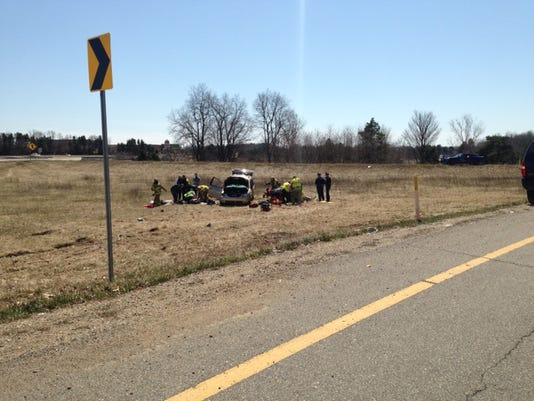 Two hurt when minivan rolls over on exit from M-66 to I-94