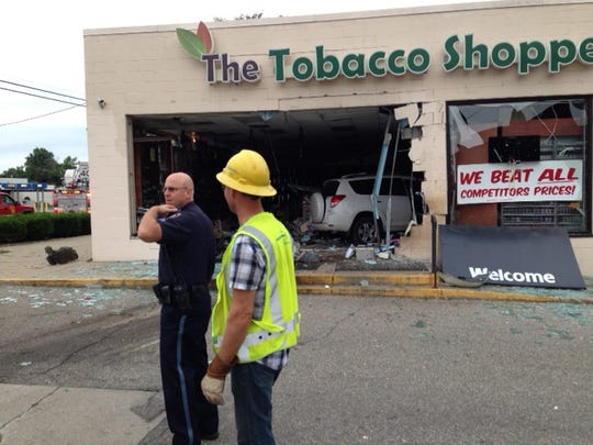A vehicle that slammed into The Tobacco Shoppe on East Columbia Avenue this morning wound up completely inside the store.