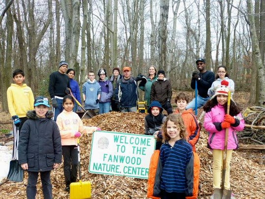 Volunteers work together to clean up the Fanwood Nature Center at last year's event.