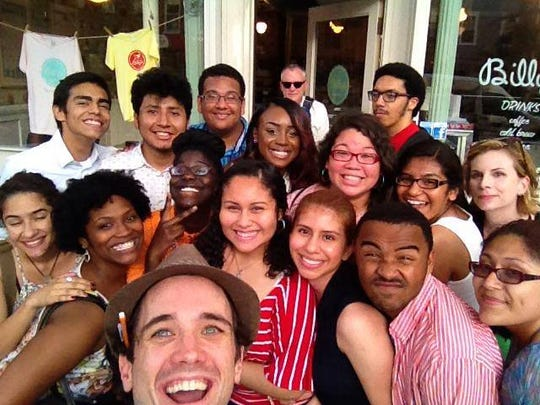 coLAB Director of Education John Keller, front, and Board President Jeffrey Longhofer, back, are pictured with Summer Theater Immersion students visiting New York City.