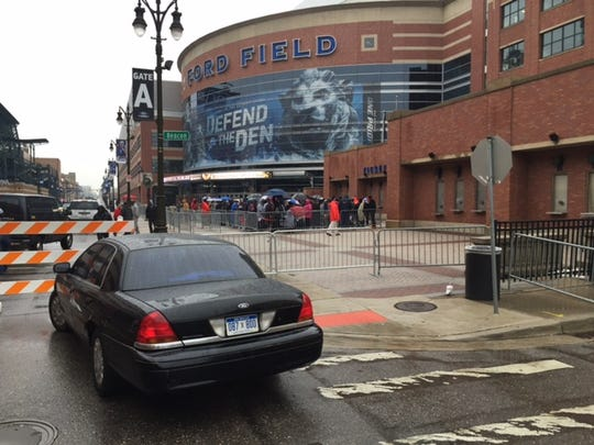 A barricade surrounds the ticket booth at Ford Field, and those selected to receive free tickets to Monday night's game featuring the New York Jets and the Buffalo Bills, which was moved from Buffalo after 7 feet of snow fell last week.