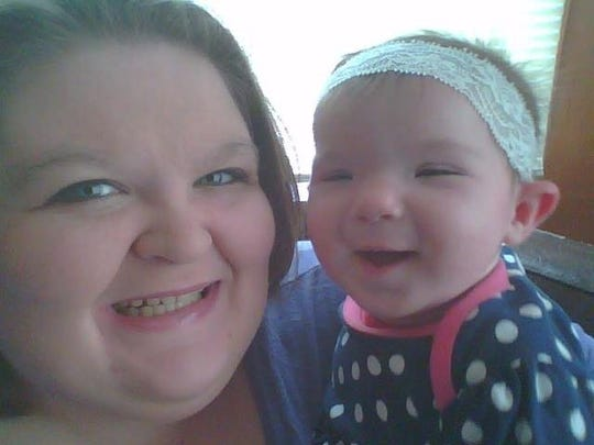 Amanda Hendrick and daughter Charley. The baby and her father were killed in late November. Grandmother Sylvia Majewska is charged in the killings.
