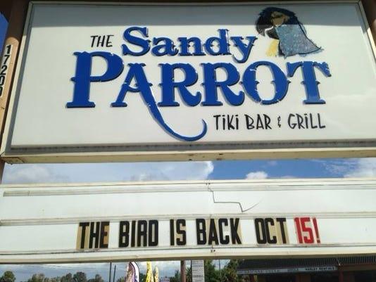 sandy parrot new sign