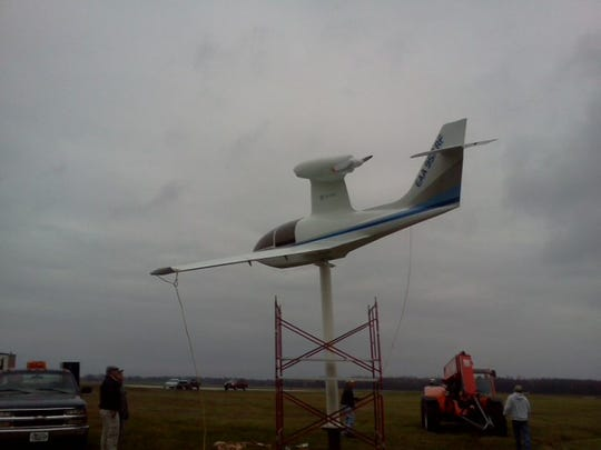 A crew Tuesday installs an Airshark designed by Florida inventor Arthur Lueck at Door County Cherryland Airport.