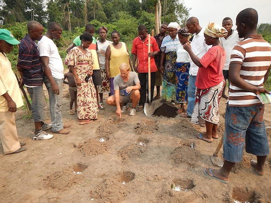 Travis Sheets is shown teaching agricultural techniques to farmers in the Liberian village of Zordee.
