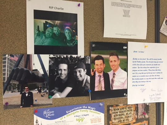 A bulletin board next to the Lewis Cass Building's cafeteria in Lansing served as a memorial to Charles Glime, who managed the cafeteria. Glime died after being struck by a vehicle this week.