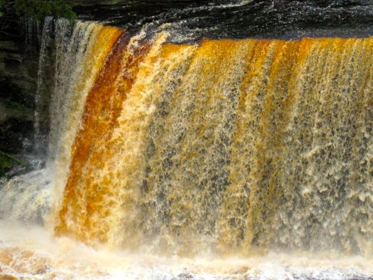 Sediment and soil runoff causes these root beer-colored falls.