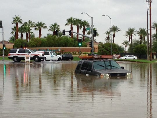 Flooding on Las Montanas Road across from Sun City Palm Desert stopped this sport utility vehicle Monday morning.