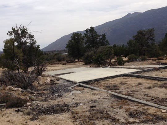 The concrete foundation is all that remains of a home on 68-550 Alpine Drive in Pinyon Pines on March 11, 2014. Three people were killed then the house was set on fire on Sept. 17, 2006.
