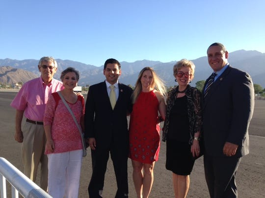L to R: Stewart Boxer, Sen. Barbara Boxer, Congressman Raul Ruiz, Monica Ruiz, Rancho Mirage Mayor Iris Smotrich and Agua Caliente Tribal Chairman Jeff Grubbe prepare to greet President Obama and Michelle Obama at Palm Springs International Airport on Friday, June 13, 2014.
