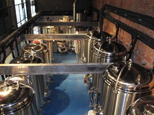 Craft beers brewed through the 15-barrel system at the Blue Collar Brewery in Poughkeepsie serve the brewpub's customers and are distributed to local bars and restaurants.