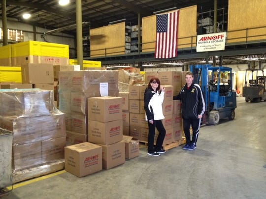 Kieran and Donna McIlvenny drop off boxes of books at Arnoff's Storage.