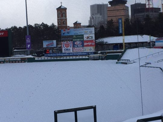 The Frontier Field scoreboard thermometer reads 4 degrees on Thursday afternoon, Feb. 15, 2015. The snow isn't going anywhere anytime soon, that's for sure.