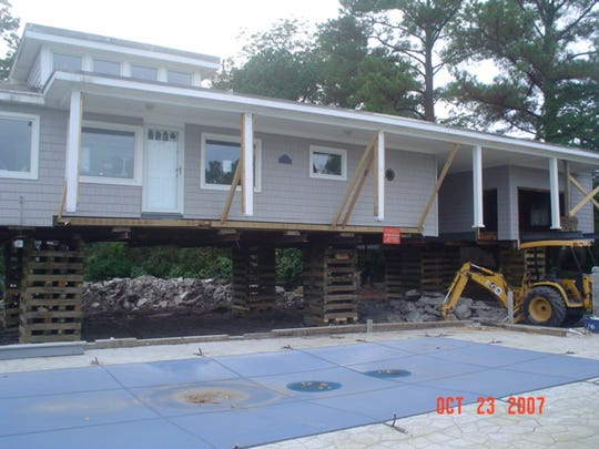 When Debbie Miller and husband Gary Chiaverotti had four feet added to the foundation of their Norfolk, Virginia home, seen Oct. 23, 2007, the Federal Emergency Management Agency paid 95 percent of the $140,000 cost.