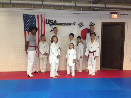 Family Taekwondo class members and instructors are Sara Hopper, front row from left, Emily Hopper, Brooke Decker; Stephon Freeman, back row from left, Daxton Frost, Zach Zurawski, Edison Jiang, Jackie Jiang and Master Stephen Decker.