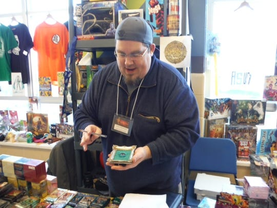 Johnny Cee Cards owner sponsors a booth at Evercon.