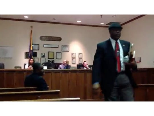 A screen grab of the meeting shows Spring Valley Deputy Mayor Anthony Leon walking out after an argument with Trustee Emilia White. Mayor Demeza Delhomme stepped between the two.