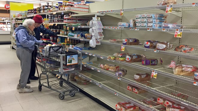 The bread aisle was low on stock at the Dobbs Ferry Stop & Shop as people shopped before the storm Monday.