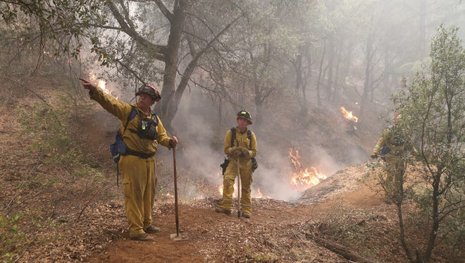 South Lake Fire Captain Dan McCale, left, and firefighter Justin Costa work on the Helena Fire in Junction City.