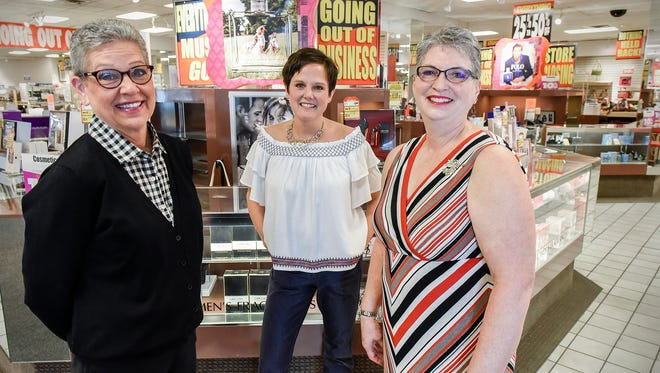 Longtime Herberger's employees Debbie Lorette, Ann Thelen and Carol Truenow talk about their jobs and friendships Thursday, May 10, at the St. Cloud store.