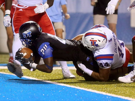 MTSU's Ty Lee (24) scores the game-winning touchdown