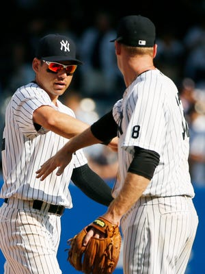 Yankees center fielder Jacoby Ellsbury, left, celebrates with third baseman Chase Headley after the Yankees defeated the Toronto Blue Jays last September. Ellsbury enters the fourth year of his deal, with a less-than-stellar .264/.326/.382 slash line as a Yankee. Ellsbury's career line was .297/350/.439 with the Red Sox.
