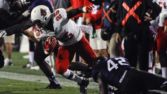 Ball State running back Darian Green gets tackled by Northwestern linebacker Joseph Jones.