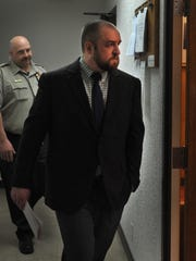 Catlin Wayne Briscoe escorted to the 89th District Court on April 11 after the jury reached its verdict. Briscoe was found guilty of reckless injury to a child causing serious bodily injury in connection to the death of a 19-month-old child.