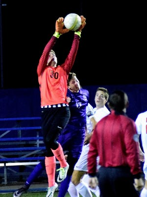 Sam Ray (30) takes to the air for an Anderson save in goal, October 27.