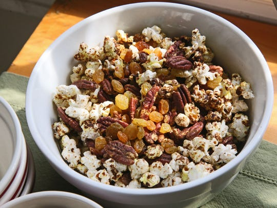 Spiced Popcorn with Pecans and Raisins gives readers