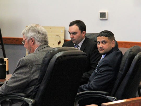 Terrick L. Thompkins, seated far left looks, looks back at the gallery during a break in his first-degree murder trial in 12th Judicial District Court.
