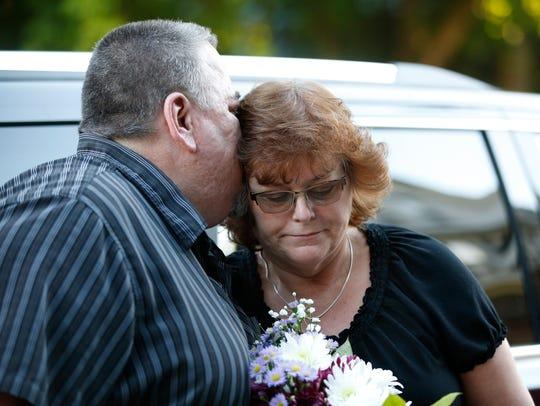 Thomas O'May kisses his wife Arlene during the vigil
