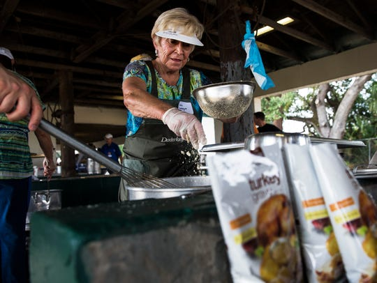 Claire Levesque prepares gravy for meals donated by