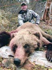 Brent Hansen of Manitowoc shows the grizzly bear he
