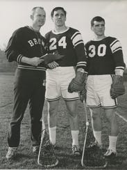 Thomas Draper, center, attends a captains' meeting