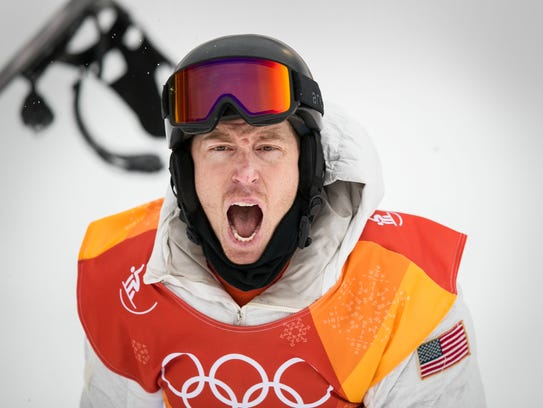 Halfpipe champion snowboarder Shaun White, throws his