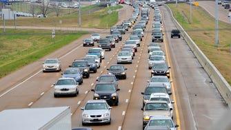 Motorists navigate Interstate 55 in Jackson, Miss.