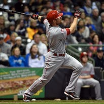 Reds shortstop Zack Cozart hits a 3-run home run in the sixth inning Monday against the Milwaukee Brewers at Miller Park.