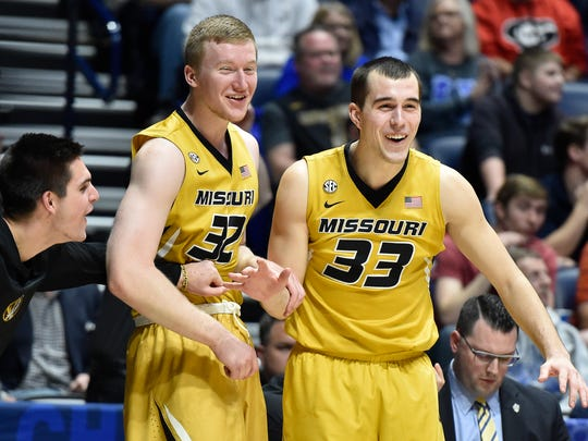 Missouri forward Adam Wolf (32) and guard Cullen VanLeer (33) celebrate with a teammate on the bench during the second half their game against Auburn in the 2017 SEC Men's Basketball Tournament at Bridgestone Arena Wednesday, March 8, 2017 in Nashville, Tenn.